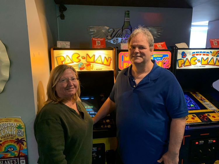 The Brenemans at Player1Up Arcade in Rock Hill, SC. Pac-Man is celebrating 40 years, and the Brenemans are celebrating their 40th anniversary this year as well [Image by Frank Breneman]