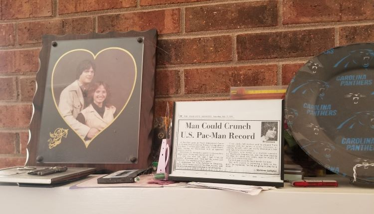 The mantel display from the Breneman household with a copy of the article announcing the Pac-Man world record [Image by Frank Breneman]